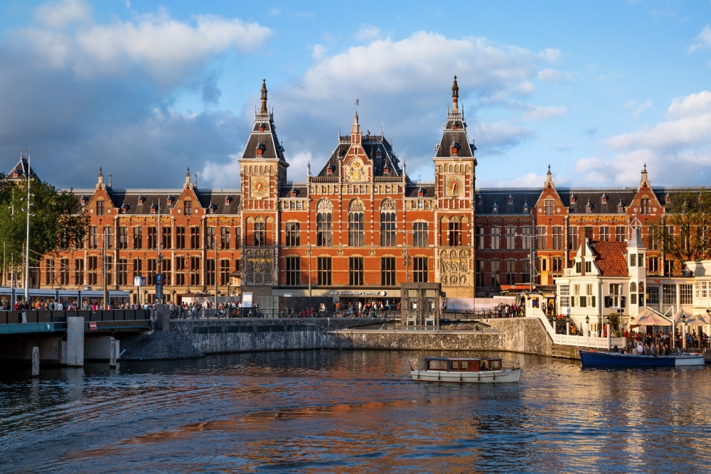 The view across the canal of Amsterdam Centraal train station.