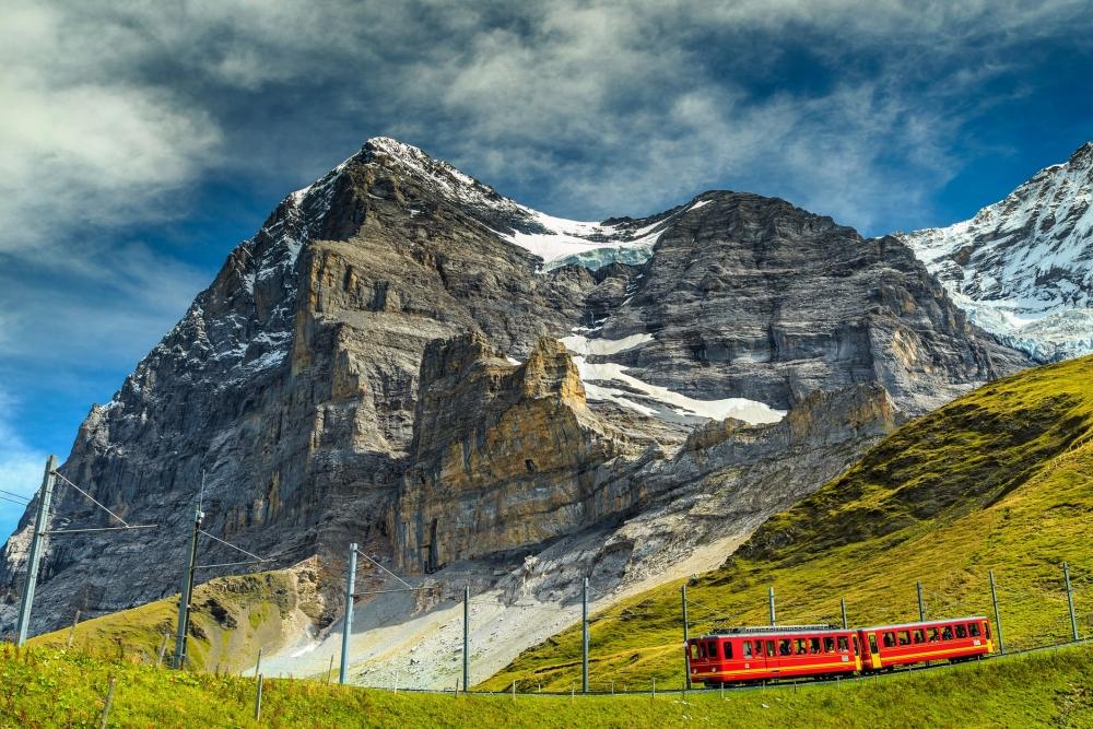View from below of the mountainside Eigerwand train station in Switzerland.