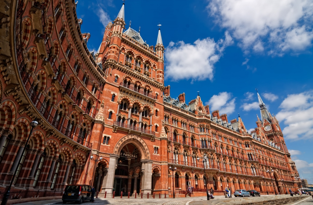 The red stone facade and entrance way of St. Pancras station.