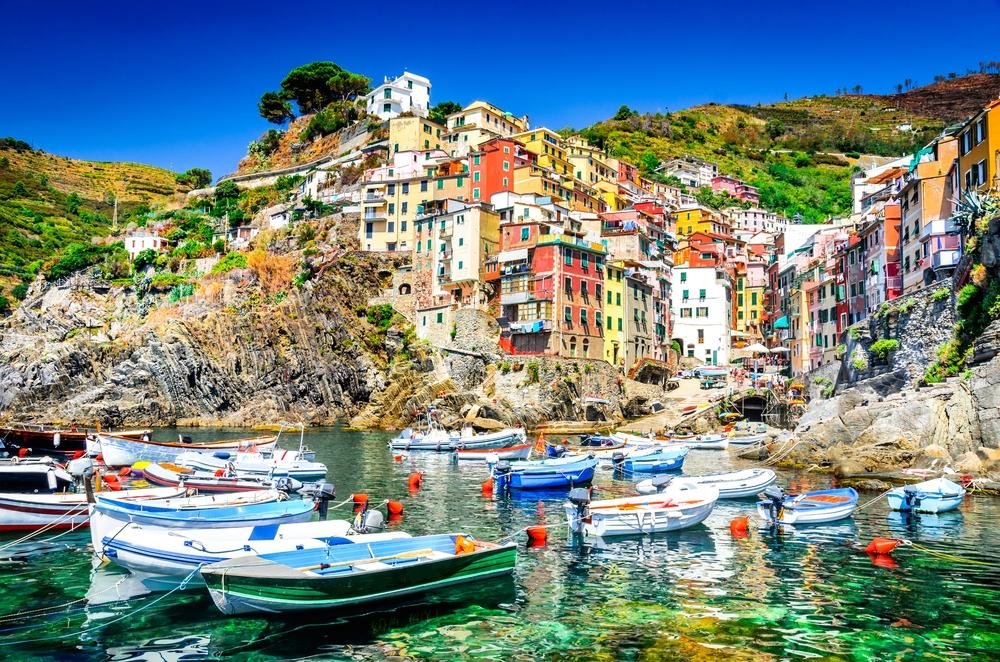 Riomaggiore with boats and ocean